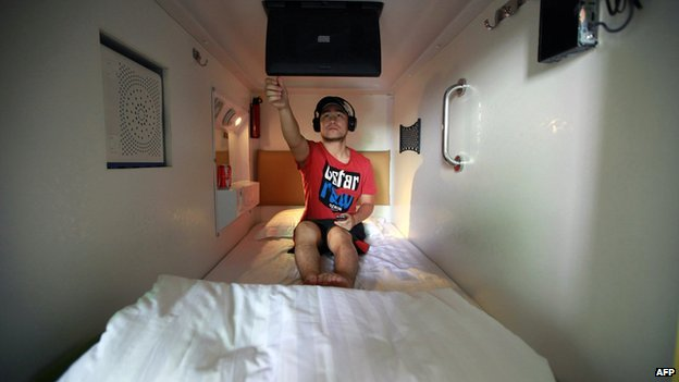 Man in hotel bedroom