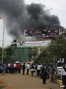 Smoke rises from the roof top of the Westgate centre, on September 23, 2013