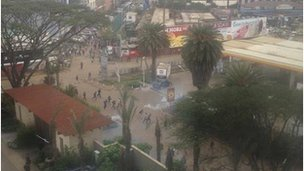 Photo by Komla Dumor taken from window showing crowds and teargas.