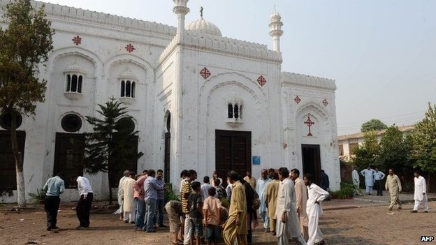 Pakistani Christian gather at All Saints church in Peshawar on September 23, 2013, the day after a suicide bomb attack