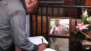 A well-wisher signs the condolences book for Ghanaian poet, professor, and former ambassador Kofi Awoonor