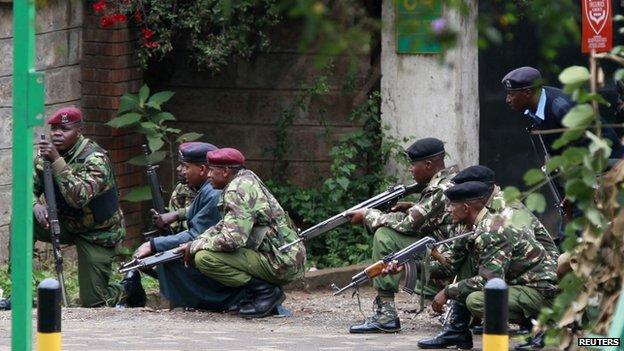 Kenyan police officers take position during the ongoing military operation at the Westgate Shopping Centre