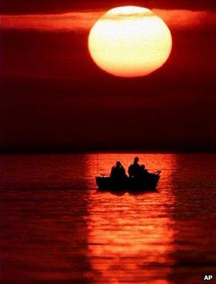 Fishing boat at sunset (Image: AP)