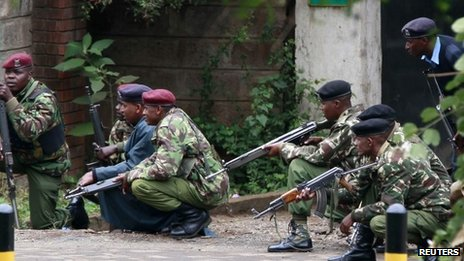 Kenyan police officers take position during the ongoing military operation at the Westgate Shopping Centre in the capital Nairobi, September 23, 2013