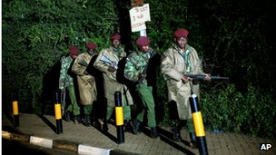 Kenyan soldiers leave the near vicinity of the Westgate Mall.