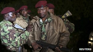 Kenyan soldiers stand near the Westgate shopping centre as the crisis pushes on into its third night.