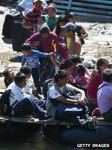 Undocumented Guatemalans prepare to cross the Suchiate River from Guatemala into Talisman, Mexico 1 August 2013