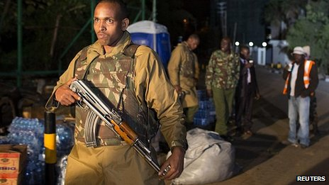 Armed police patrol security perimeter around Westgate shopping centre in Nairobi. 24 Sept 2013
