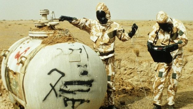Weapons inspectors in protective clothing working Iraq, after the 1991 Gulf War