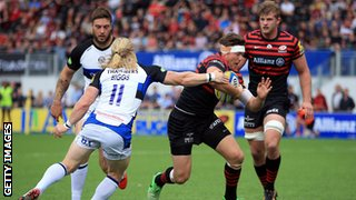 Saracens' Alex Goode dives over to score a try during their match against Bath