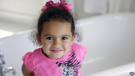 Veronica, the child at the centre of an international adoption dispute, smiles in a bathroom of the Cherokee Nation Jack Brown Center in Tahlequah, Oklahoma 6 August 2013