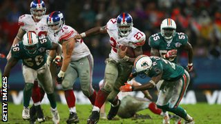 Brandon Jacobs of New York Giants carries the ball during their 2007 match against Miami Dolphins at Wembley