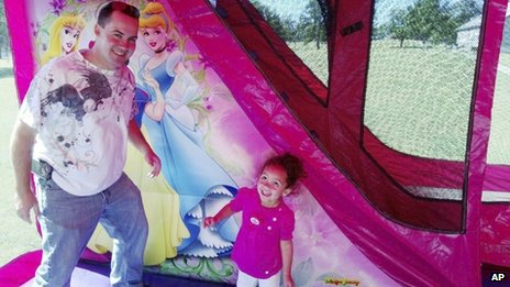 Veronica, right, with her biological father, Dusten Brown, at a birthday party for her in Tahlequah, Oklahoma