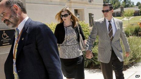 Melanie and Matt Capobianco (right) arrive at Oklahoma Supreme Court in Oklahoma City on 3 September 2013