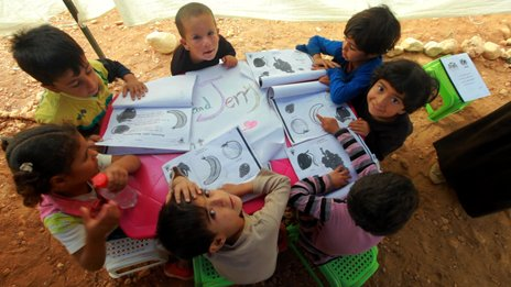 Children in a makeshift classroom