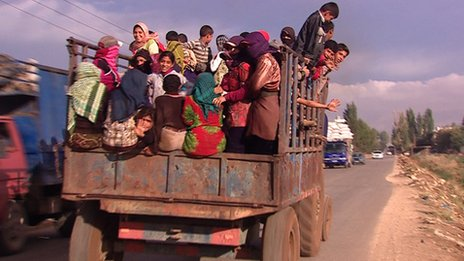 A truck packed with Syrian children off to the fields