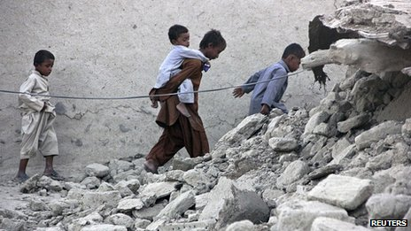 Children among the rubble of homes in Awaran. 25 Sept 2013