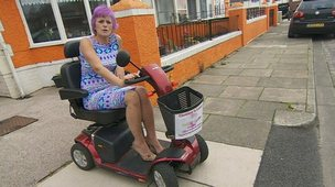 A woman on a mobility scooter