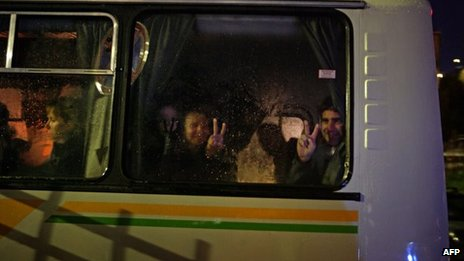 """Greenpeace activists flash """"V for victory"""" signs as they arrive at the offices of the Russian Investigative Committee in Murmansk (photo from Greenpeace)"""