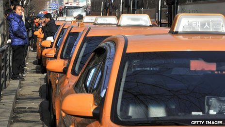 South Korean drivers stand beside taxis in Seoul