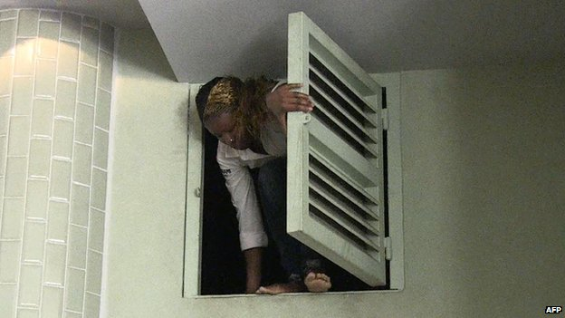 A woman climbing out of a hatch
