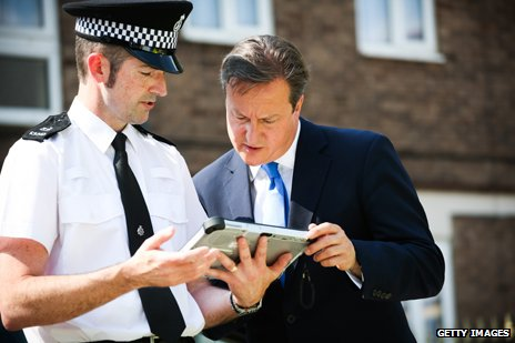 David Cameron and policeman, 2013