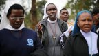 Catholic nuns pray near the Westgate Mall in Nairobi, Kenya, Wednesday, 25 September 2013.