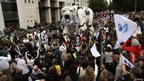 A giant polar bear marionette leads a street parade organised by Greenpeace