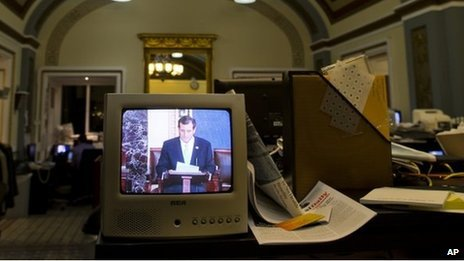 Senator Ted Cruz is seen on a television screen in the Senate Press Gallery during the tenth hour of his speech on the Senate floor 25 September 2013