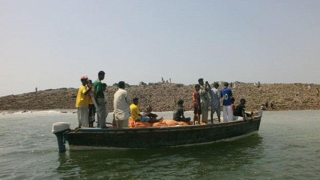 A boat near an island that appeared two kilometres off the coastline of Gwadar on 25 September, 2013.