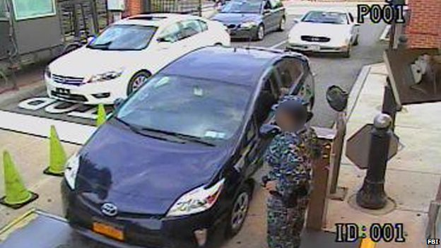 Aaron Alexis drives his rented blue Toyota Prius through the Washington Navy Yard main gate on 16 September