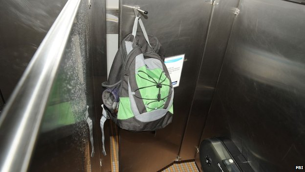 Aaron Alexis' backpack hangs on the back of a stall door inside the fourth-floor men's bathroom