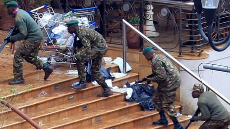 Soldiers approach the Westgate shopping centre in Nairobi