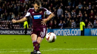 Hearts player Dale Carrick scores a penalty