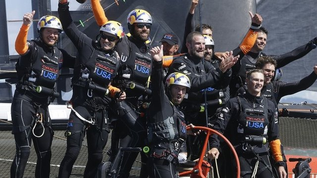 Oracle Team USA crew, including skipper Jimmy Spithill and tactician Sir Ben Ainslie, celebrate after winning the 19th race against Emirates Team New Zealand