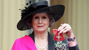 April Ashley with her MBE medal