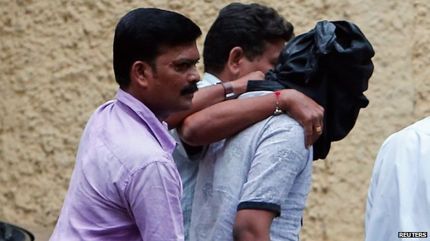 File photo of Indian police escorting a masked rape suspect into Mumbai court on 24 August 2013
