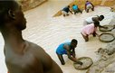 Workers pan for diamonds in a government controlled diamond mine June 15, 2001 near Kenema, Sierra Leone.