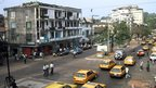 A general view taken 19 February 2002 shows a main avenue of the Liberian capital Monrovia, where traffic and daily life appears normal