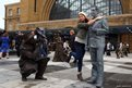 Shannon Serrao from London poses with a living statue outside King's Cross Station