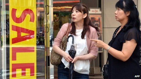 Shoppers outside a shop in Japan