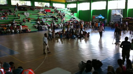 Survivors gather in a sports centre in Acapulco September 2013