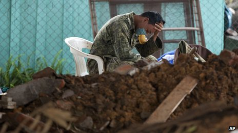 A soldier takes a break during the search for bodies in La Pintada, Mexico on 22 September