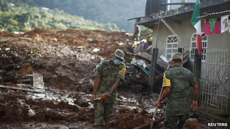 Soldiers clear mud to search for bodies in the village of La Pintada, in the Mexican state of Guerrero, on 20 September 2013.