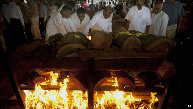 Family members light the funeral pyre of Mitul Shah, of Bidco Group of Kenya, who was shot dead in the attack on the Westgate Mall, at the Hindu Crematorium in Nairobi, Kenya 26 Thursday September 2013