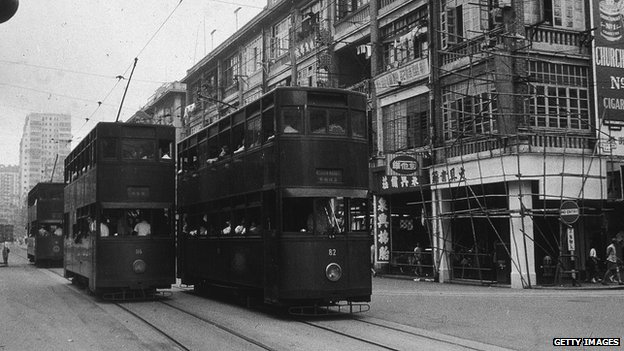 Double-decker trams passing the junction of Tin Lock Lane and Hennessy Road in Wan Chai, circa 1960s
