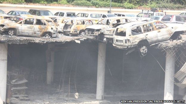 The remains of cars and other debris can be seen in a general view photographed from the rooftop, of the parking lot outside the Westgate Mall on 26 September 2013