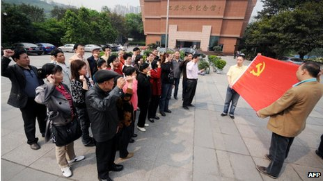 Residents gather to sing red songs at a park in Chongqing on 20 April 2011