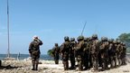 Government soldiers salute the Philippine national flag, after taking over a command post of the Muslim rebels of the Moro National Liberation Front (MNLF) in the outskirts of Zamboanga city.