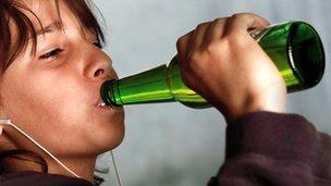 Nine-year-old boy drinking (model)